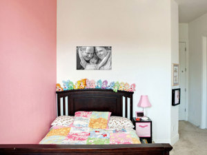 Family-portrait-canvas-in-baby-girls-room