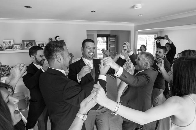 Groom-dances-at-the-house-with-his-family-befoere-the-ceremony