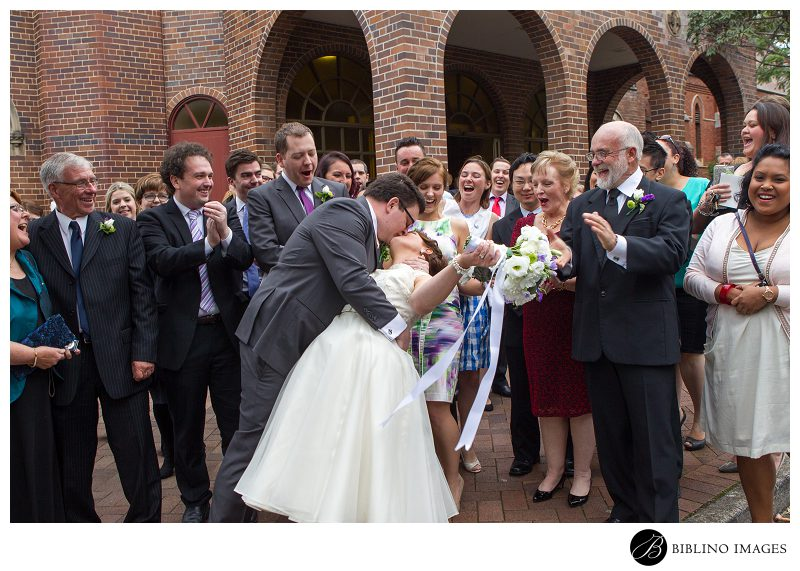 Sydney-Catholic-Church-Wedding-Bride-and-Groom-Kiss-outside-of-church-photo-by-Biblino-Images