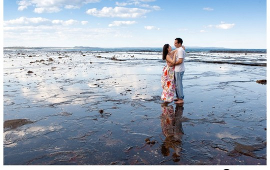 Engaged-couple-pose-while-portraits-are-taken-of-them-down-the-south-coast-of-NSW