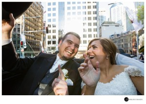 Bride-groom-sing-out-loud-while-driving-through-the-sydney-CBD-in-a-converable-limo
