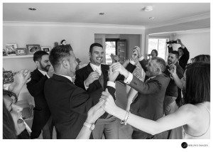Groom-dances-with-family-and-guests-at-the-house