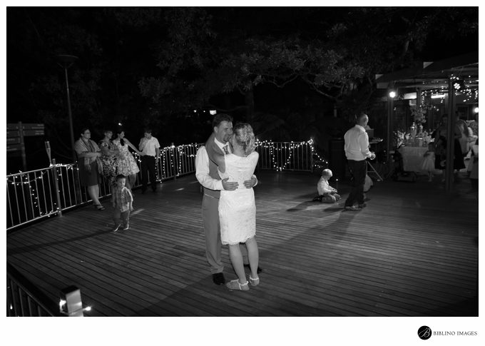 Bride Groom first dance under moonlight on the deck of the botanical gardens cafe