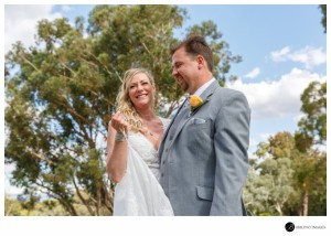 Bride-smiles-during-wedding-cermeony