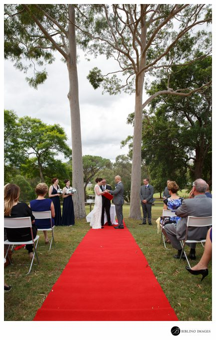Wedding ceremony under two gum trees