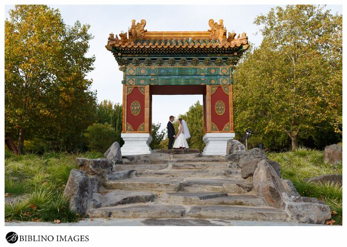 Bride groom pose at the gate of Canberra Beijing garden