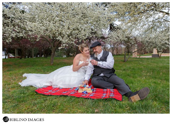 Bride and groom have a picnic during their wedding day Lennox gardens