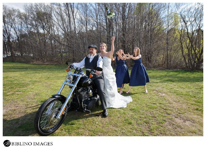 bride throws bouquet while on a harley davidson