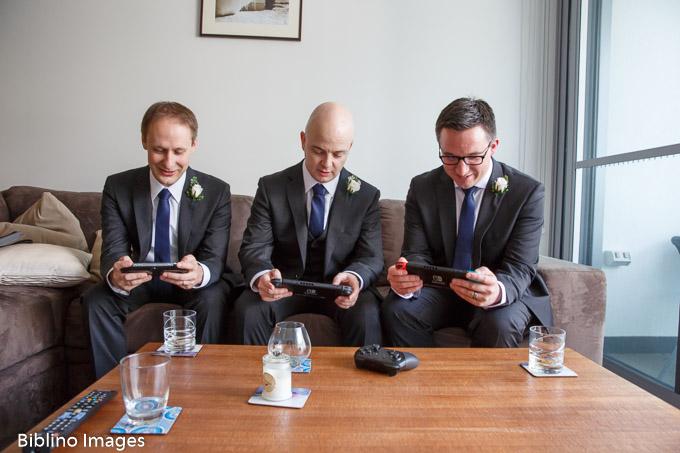Groomsmen playing computer games